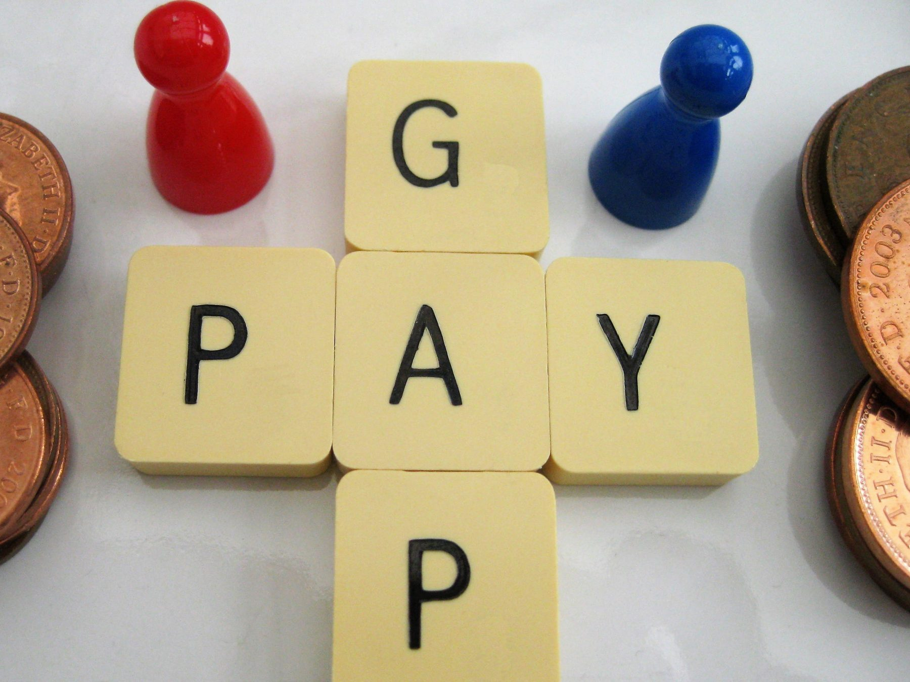 Pay gap spelled out in scrabble tiles